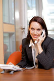 Businesswoman conversing on landline phone, portrait Royalty Free Stock Photos