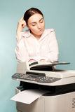 Businesswoman with copier Royalty Free Stock Photos