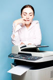 Businesswoman with copier thinking Royalty Free Stock Photos