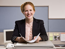 Businesswoman copying papers in office Royalty Free Stock Images