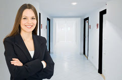 Businesswoman in a corridor Stock Photos