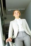 Businesswoman in corridor Royalty Free Stock Photo
