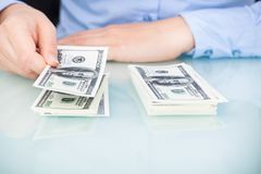 Businesswoman counting bank note Royalty Free Stock Photography