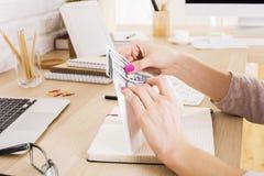 Businesswoman counting money Stock Photos