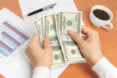 Businesswoman counting money Stock Photo