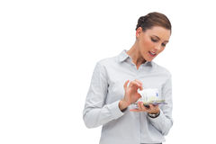 Businesswoman counting money Royalty Free Stock Photos