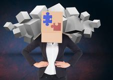 Businesswoman covered with cardboard box showing jigsaw puzzles and white cubes in backgrounds. Digital composition of businesswoman covered with cardboard box Stock Image