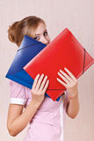 Businesswoman covered his face folders Stock Photography