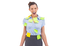 Businesswoman covered with sticky notes Royalty Free Stock Images