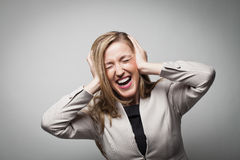 Businesswoman covering ears Royalty Free Stock Photo