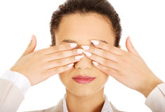 Businesswoman covering eyes with hands. Stock Photos