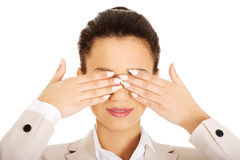 Businesswoman covering eyes with hands. Stock Photo