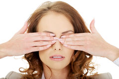 Businesswoman covering eyes with hands. Royalty Free Stock Photography