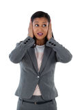 Businesswoman covering her ears. Hear no evil concept Stock Images