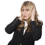 Businesswoman covering her ears Royalty Free Stock Photography