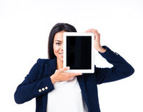 Businesswoman covering her eye with tablet computer Royalty Free Stock Photo
