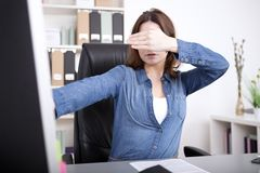 Businesswoman covering her eyes Royalty Free Stock Photography
