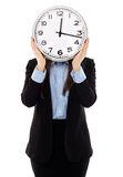 Businesswoman covering her face with a clock Royalty Free Stock Images