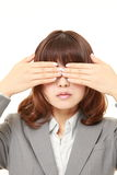 Businesswoman covering her face with hands Royalty Free Stock Photo