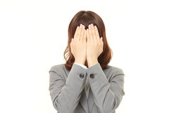 Businesswoman covering her face with hands Stock Image