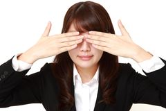 Businesswoman covering her face with hands Stock Images