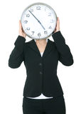 Businesswoman Covering Her Head With Clock Stock Photography