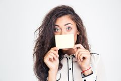 Businesswoman covering her mouth with blank card Royalty Free Stock Photo