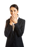 Businesswoman covering her mouth Stock Photography