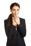 Businesswoman covering her mouth Royalty Free Stock Images