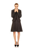 Businesswoman covering her mouth. Royalty Free Stock Photo