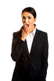 Businesswoman covering her mouth Stock Images