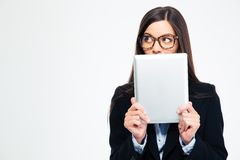 Businesswoman covering her mouth with tablet computer Royalty Free Stock Images