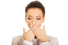 Businesswoman covering mouth with hands. Royalty Free Stock Images