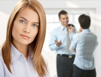 Businesswoman with coworkers Royalty Free Stock Photos