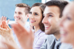 Businesswoman with coworkers in background Stock Images