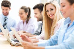 Businesswoman with coworkers. Business people meeting at table royalty free stock images