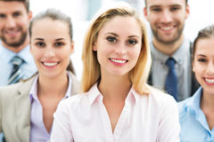 Businesswoman with coworkers. Business people meeting at table stock images