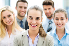 Businesswoman with coworkers. Business people meeting at table stock image