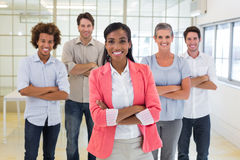 Businesswoman and coworkers smiling at camera Royalty Free Stock Image