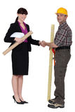 Businesswoman and craftsman Stock Photography