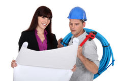 Businesswoman and craftsman Royalty Free Stock Image
