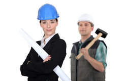Businesswoman and craftsman Stock Image