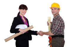 Businesswoman and craftsman Royalty Free Stock Photography
