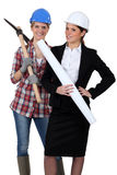 Businesswoman and craftsman Royalty Free Stock Photos