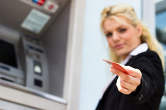 Businesswoman with credit card at the ATM Royalty Free Stock Photos