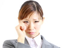 Businesswoman cries. Concept shot of Japanese businesswoman Royalty Free Stock Images