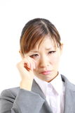 Businesswoman cries. Concept shot of Japanese businesswoman Royalty Free Stock Photography