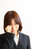 Businesswoman cries Stock Photo