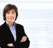 Businesswoman with crossed arms Stock Photos