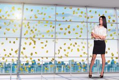 Businesswoman with crossed arms under money rain Royalty Free Stock Photos